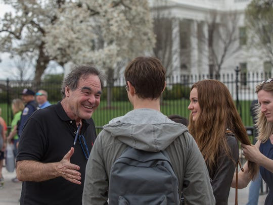 Oliver Stone works with his 'Snowden' stars Joseph