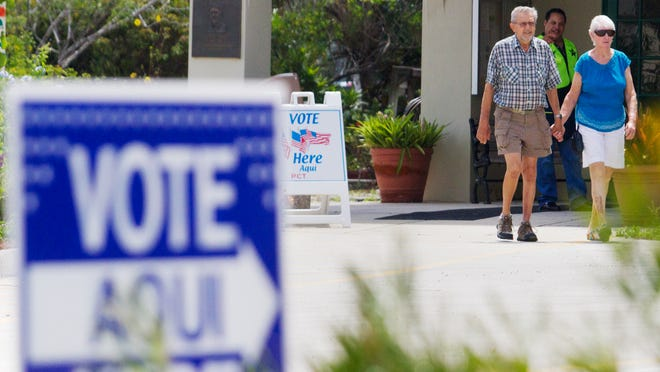 Voters leave Terry Park in Fort Myers after voting Saturday