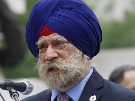 K.P. Singh of the Sikh Temple of Indiana is shown speaking