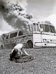 The Freedom Riders' bus was firebombed by an angry