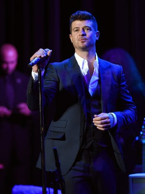 "FILE - In this Thursday, Feb. 5, 2015 file photo, singer Robin Thicke performs at the 17th Annual GRAMMY Foundation Legacy Concert at the Wilshire Ebell Theatre in Los Angeles. A jury says singers Pharrell Williams and Thicke copied a Marvin Gaye song to create ""Blurred Lines"" and awarded more than $7 million to Gaye's family. The eight-person panel reached the decision Tuesday, March 10, 2015, after hearing nearly a week of testimony about similarities between ""Blurred Lines"" — the biggest hit of 2013 — and Gaye's 1977 hit ""Got to Give It Up.""  (Photo by Chris Pizzello/Invision/AP, File)"