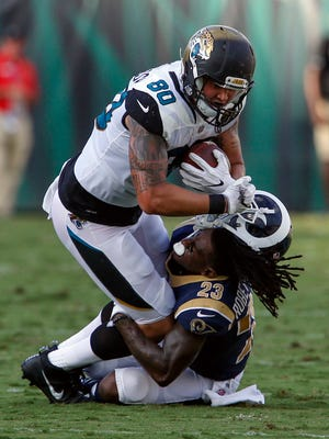 Rams cornerback Nickell Robey-Coleman loses his helmet after tackling Jaguars tight end James O'Shaughnessy.