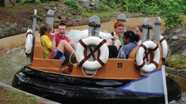 Kids enjoying the Smoky Mountain River Rampage at Dollywood during the park's 30th anniversary in 2015.