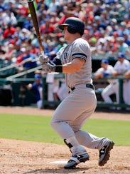 New York Yankees' Tyler Austin follows through on a