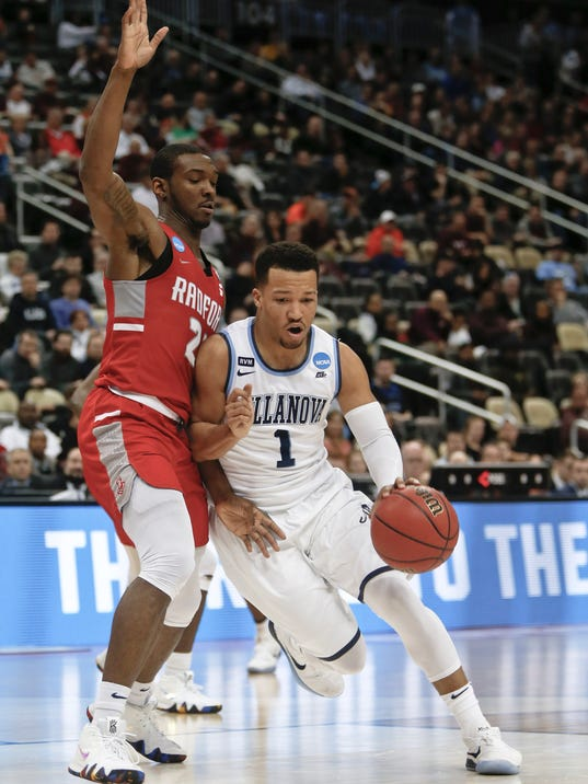 FILE - In this Thursday, March 15, 2018, file photo, Villanova's Jalen Brunson (1) drives on Radford's Ed Polite Jr. during the second half of an NCAA men's college basketball tournament first-round game in Pittsburgh. Villanova takes on West Virginia in a regional semifinal on Friday. (AP Photo/Keith Srakocic, File)