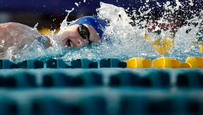 In a file photo from April 15, 2015, Katie Ledecky wins her heat in the 1500  freestyle prelims during the 2015 Arena Pro Swim Series at the Skyline Aquatic Center.