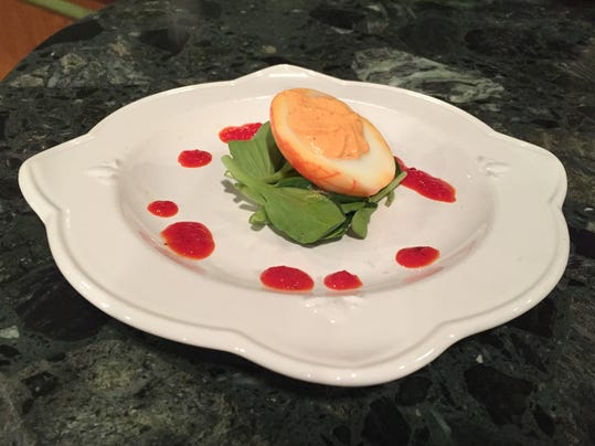 This Deviled Brains dish is made with hard-boiled eggs and a creamy roasted red pepper filling. The dish will be served at the Offcenter Grill in downtown York through Halloween.