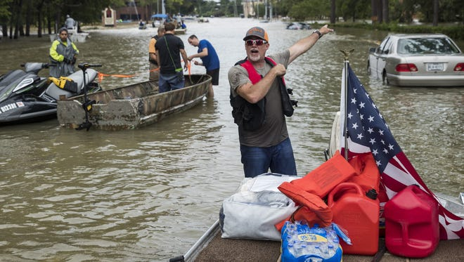 Blake Kuklin prepares to rescue more peoplle at Eldridge Parkway in the Energy Corridor of west Houston where residents were evacuating from their flooded homes and apartments after Hurricane Harvey on Aug. 30, 2017 in Houston.