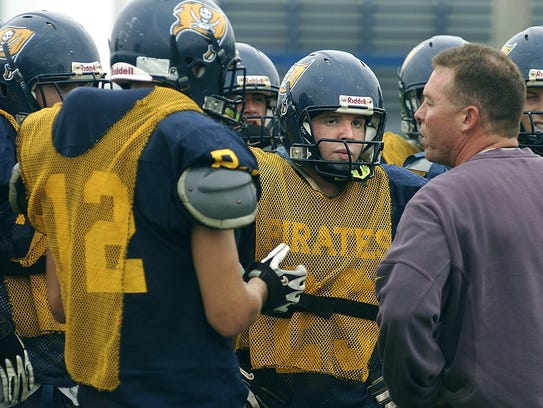 George Heckman, right, as coach to the Pewamo-Westphalia
