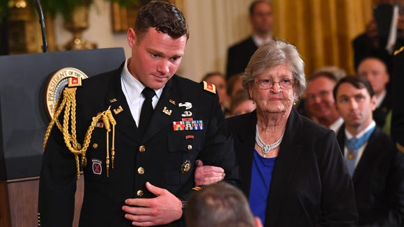 Pauline Conner, the widow of Kentucky soldier 1st Lt. Garlin M. Conner, is escorted to her seat before President Donald Trump would posthumously honor him with the Medal of Honor on Tuesday, June 26, 2018, for his actions in World War II.