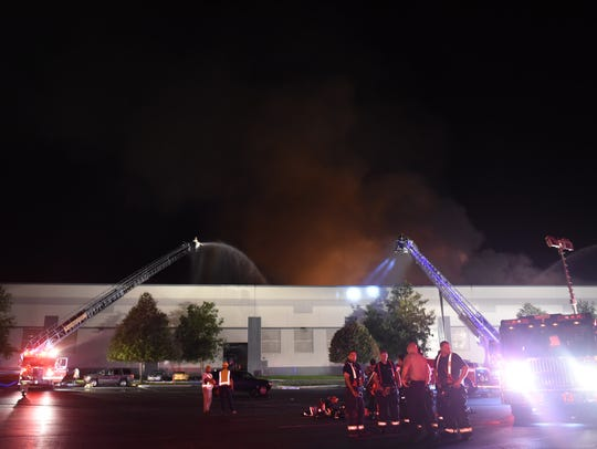 Fire departments fight the warehouse fire at the Gap