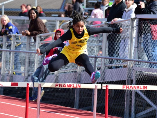 North Farmington's Lauryn Williams gets after it during
