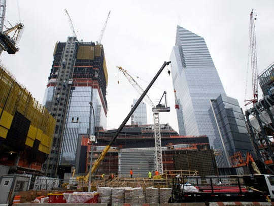 Construction cranes tower over the large-scale redevelopment