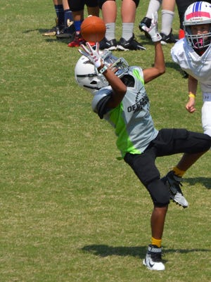 Port Huron's De'Christopher Green leaps for a catch at the Offense-Defense Camp in Charlotte, N.C.