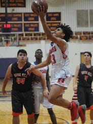 Cooper's Noah Garcia (13) drives to the basket against