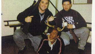 Chicago Police Officers Jerome Finnigan, left, and Timothy McDermott with an unidentified man.