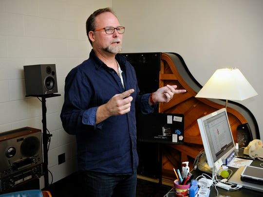 St. Cloud State University professor and composer Scott Miller talks about his work from his office May 6 in the Performing Arts Center. Miller spent time in Estonia through a Fulbright scholarship.