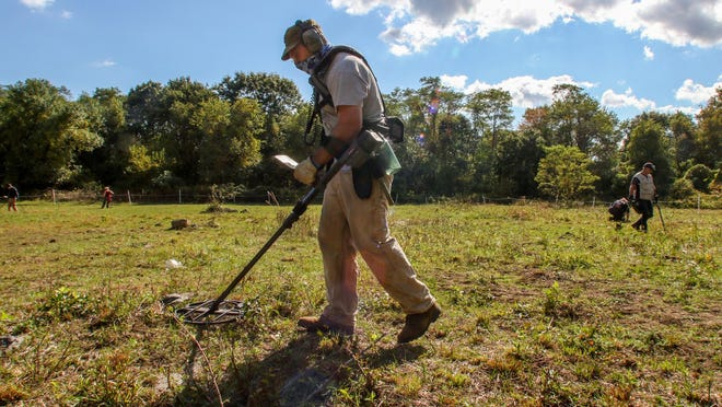 """Relic hunters search for natural finds along with planted coins during a metal detector treasure hunt named """"Pound the Ground"""" on Saturday at the former Hazard Farm in North Kingstown."""