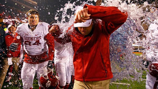Oklahoma football coach Bob Stoops reacts as he is doused in the closing seconds of a game against Oklahoma State.