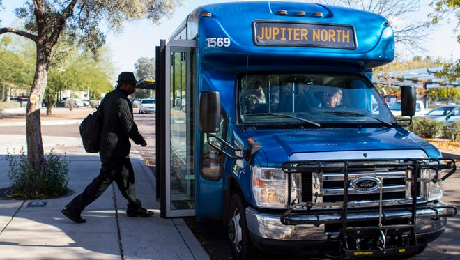 Brian Johnson boards an Orbit bus at the Tempe Public Library stop on Tuesday, Dec. 15, 2015 in Tempe, Ariz. The bus service is expanding its routes of service in Tempe.