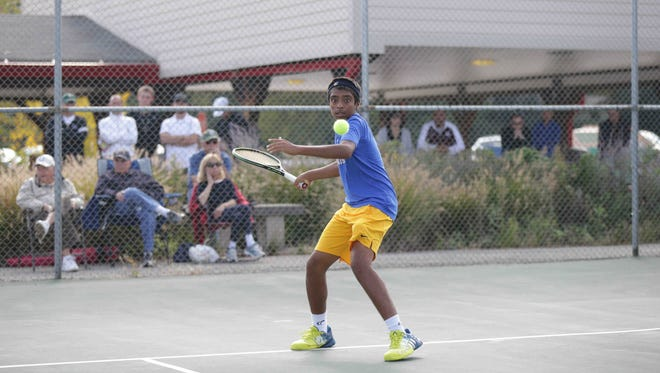 Nishanth Basavareddy returns the ball during the High School Boys Tennis State Finals, geld at North Central High School, Saturday October 15th, 2016.