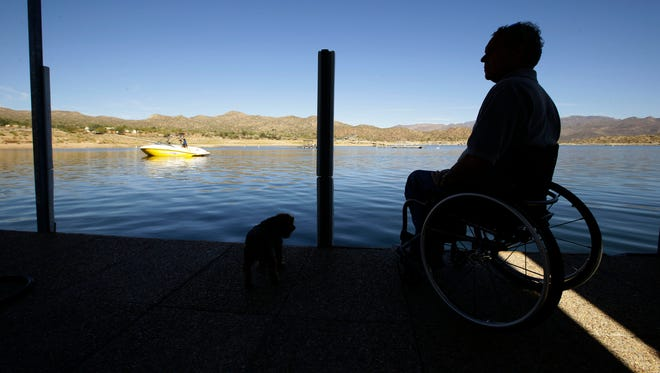 Bryan Church owner of the Bartlett Lake Marina and his dog Hurley on Oct. 26, 2016 in Carefree, Ariz.