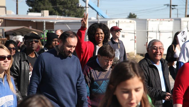 More than 70 Carlsbad residents attended the annual Martin Luther King Jr. march on Monday. Nepheterii Young (red jacket) said she hope that people embrace the dream King Jr. once had for the country.