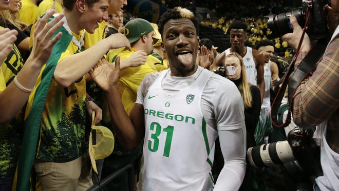 Feb 18, 2017; Eugene, OR, USA; Oregon Ducks guard Dylan Ennis (31) celebrates with fans at the end of the game against the Colorado Buffaloes at Matthew Knight Arena. Mandatory Credit: Scott Olmos-USA TODAY Sports