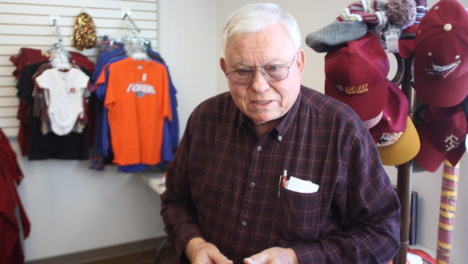 Billy Hudson walked through the newly re-opened Lighthouse Children's Home Thrift Store Monday, nearly nine months after it was burned to the ground by arsonists.