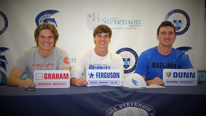Parker Graham (from left), George Ferguson and Devin Dunn celebrate together as they announce their college choices during a recent ceremony. All played football, basketball and baseball throughout their prep careers.