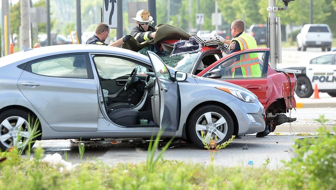 Green Bay Police work the scene of a multiple vehicle crash at the intersection of Lombardi and Ashland avenues.