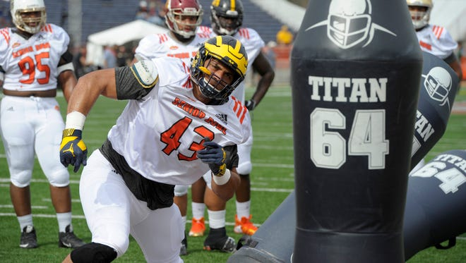 Defensive end Chris Wormley of Michigan participates in a drill during Senior Bowl practice Jan 25, 2017, at Ladd-Peebles Stadium.