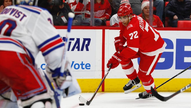 Detroit Red Wings left wing Andreas Athanasiou (72) skates in on New York Rangers goalie Henrik Lundqvist (30) in the second period at Little Caesars Arena.