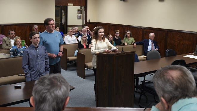 Eighth-grade student Sydney Goettler (at podium) prepares to address the Mountain Home City Council on Thursday night. Standing to the right of Goettler is fellow eighth-grader Ethan Campbell and health teacher Keith Newsom.