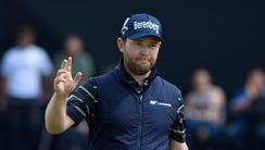 Branden Grace reacts after making a birdie putt on