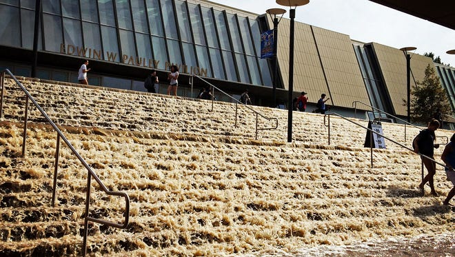 Water cascades down a stairway to a parking structure adjacent to Pauley Pavlion, home of UCLA basketball, after a 30-inch water main burst on nearby Sunset Boulevard onJuly 29 in Los Angeles.