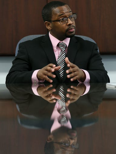 Anthony Cade is one of a new generation of ministers leading black baptist churches in Des Moines.  Sunday, April 6, 2014.