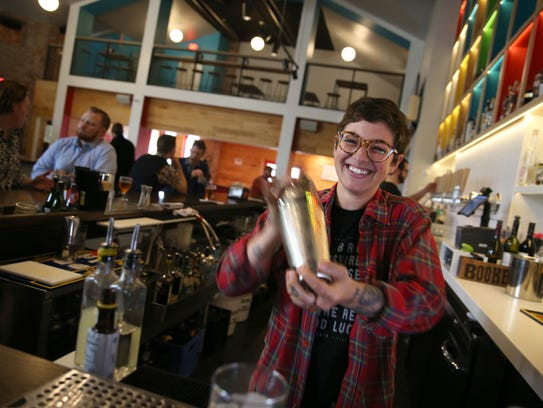 Bartender Sarah Eichas mixes and shakes a Fitzgerald