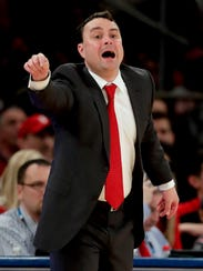 Indiana coach Archie Miller motions to players during