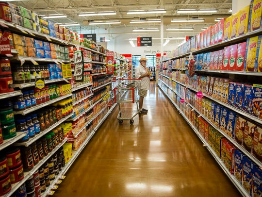 Jeff Zinnerman looks at cereal choices at the Winn-Dixie