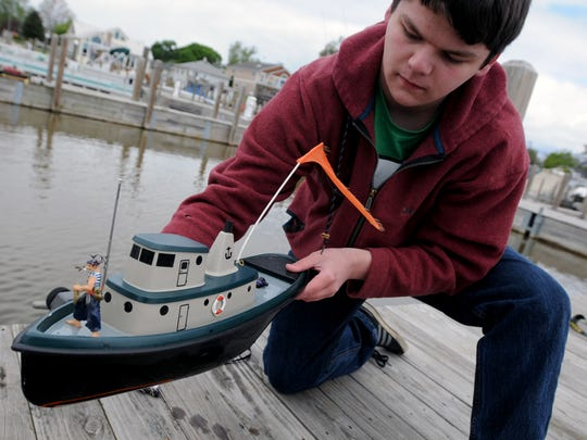 Orion Zeller, 17, of Lakeport,shows the boat he is operating  Sunday, May 15, at the St. Clair Boat Harbor.