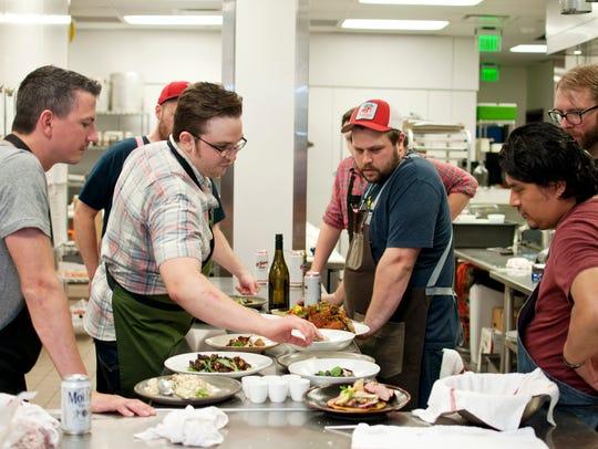 Cerulean chef Alan Sternberg, center right, gathers