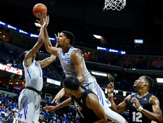 University of Memphis forward Dedric Lawson (top) is