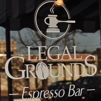 (From left) Brendan Daniels, Ashley Treib and David Williams sit in the future home of Legal Grounds, an espresso bar they are opening in downtown Alexandria.