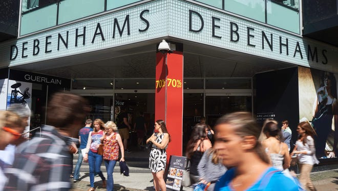 This file photo taken on Aug. 13, 2016 shows shoppers walking past a Debenhams department store on Oxford Street in central London.