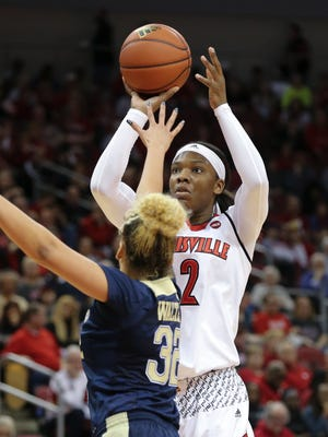 U of L's Myisha Hines-Allen (2) hits a jumper against Pittsburgh's Kalista Walters (32) at the Yum Center.    