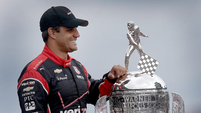 Juan Pablo Montoya poses for photos with the Borg-Warner Trophy on Monday, May 25, 2015, the day after winning the 99th running of the Indianapolis 500.
