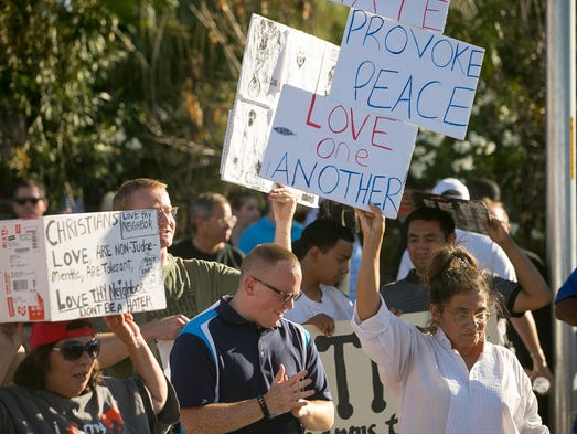 Protesters outside a mosque in Phoenix on Friday, May