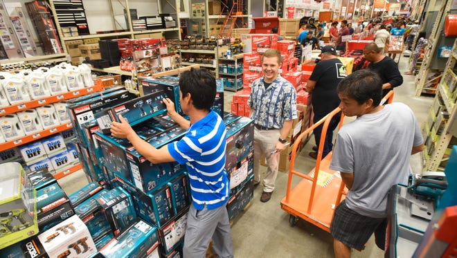 In this file photo, customers shop the Black Friday sale at The Home Depot in Tamuning on Friday, Nov. 25, 2016.