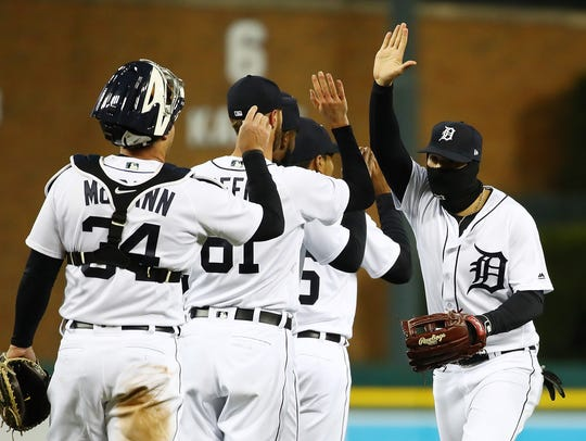 Nicholas Castellanos, right, celebrates the Tigers' 4-2 win over the Orioles at Comerica Park on Tuesday.
